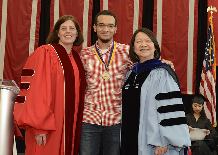 male commonwealth honors student with President Eddinger and Amy Young