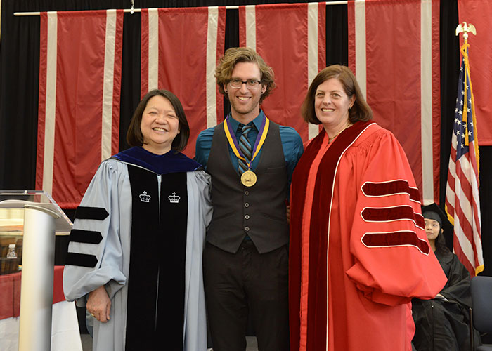 male student with the president and Amy Young
